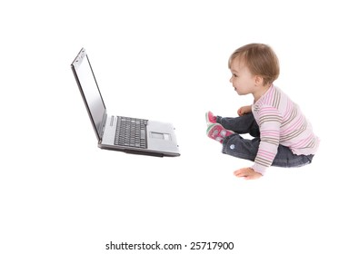 sweet baby girl playing on laptop.over white background