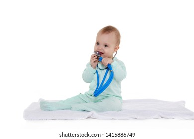 fb2acd42 Sweet baby wearing green romper suit sits with blue stethoscope on a white  background. Eight