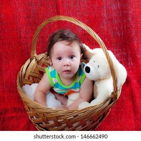 sweet baby in a wicker basket