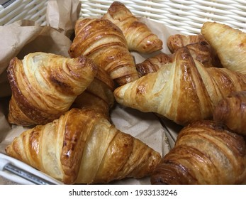 sweet baked croissant yellow color in a basket