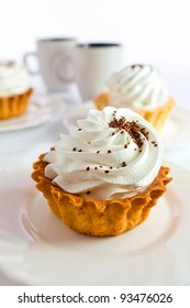 sweet baked pie on a white plate.