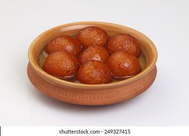 sweet balls called gulab jamun an indian sweet in a dish