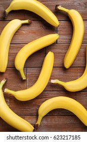 Sweet bananas on brown wooden table