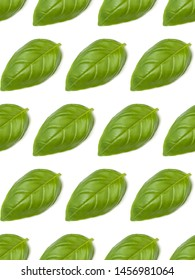 Sweet Basil herb leaves isolated on white background closeup. Flat lay, top view. Seamless pattern.