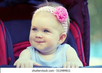 Sweet Beautiful little girl outdoors, Joyful, Happy, Excited. Closeup Headshot