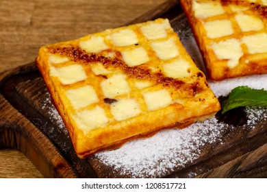 Sweet Belgian Waffer over wooden background