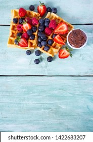 sweet belgian waffles with berries and chocolate cream