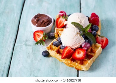 sweet belgian waffles with berries and ice cream