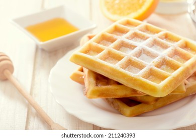 Sweet Belgian waffles with sugar icing.Selective focus on the front waffles