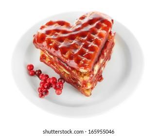 Sweet Belgium waffles with jam, isolated on white