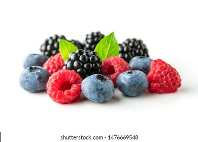 Sweet berries mix isolated on white background. Ripe raspberry, blueberry and blackberry.