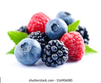 Sweet berries mix isolated on white background. Ripe raspberry and blueberries. - Shutterstock ID 516906085