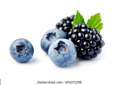 Sweet berries mix isolated on white background. Ripe blackberries and blueberries.
