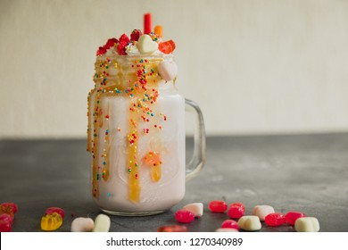 Sweet berry milkshake with whipped cream and dripping sauce