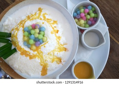 Sweet Bing Su (Bing soo) soft snow flack with colorful toppings on top. Korean ice dessert.