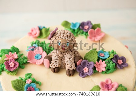 Sweet Birthday Cake Decorated With Flowers And Sugar Sheep