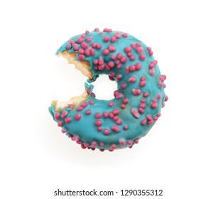 Sweet bitten donut on white background