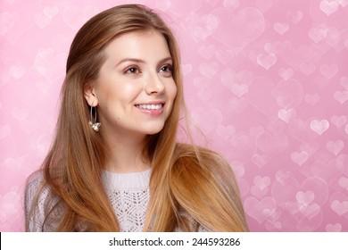 Sweet Blonde Woman Smiling Winking Valentines Day Heart Shaped Bokeh Background Joyful