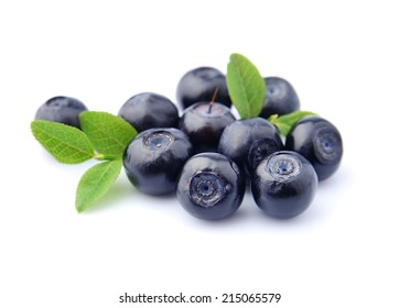 Sweet blueberries with leaves close up .