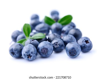 Sweet blueberries with leaves on a white background