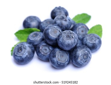 Sweet blueberries with leaves on white backgrounds.