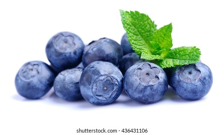 Sweet blueberries with mint leaves on white backgrounds.