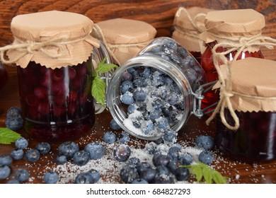 Sweet blueberries and raspberries in jars for winter