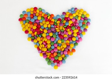 Sweet bonbons candy in heart shaped