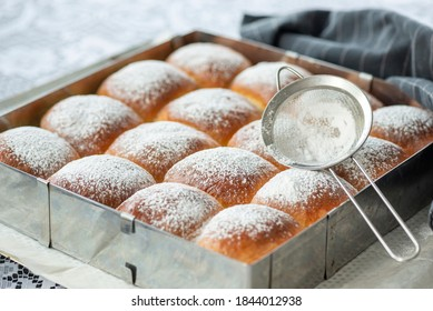 Sweet bread rolls with powdered sugar on top, close up - Shutterstock ID 1844012938