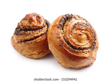 Sweet buns with poppy seeds on white background