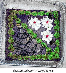 sweet cake with creme decorative flowers and chokolate lines