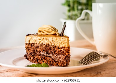 sweet cake with cup of tea on wooden table