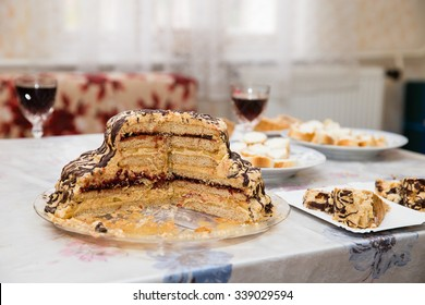 Sweet Cake on the table with other food and drinks