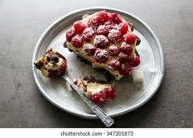 Sweet cake with raspberries on dark background