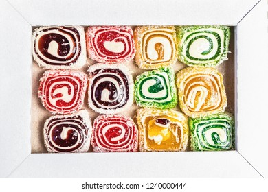 Sweet candies in the box. Cezerye or lokum. Tasty background texture. Candy texture. Top view