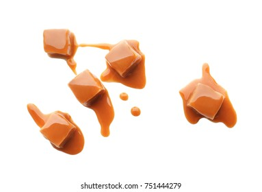 Sweet candies with caramel topping on white background