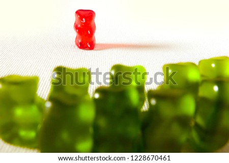 49732add5 sweet candy gummy teddy bears representing group of students or work  colleagues bullying and mobbing helpless