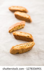 Sweet cantuccini biscuits. Italian biscotti on tablecloth.