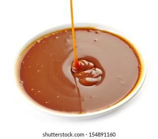 sweet caramel sauce in a white bowl