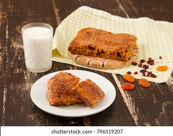 Sweet carrot cake on wooden background