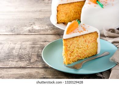 Sweet carrot cake slice on wooden table