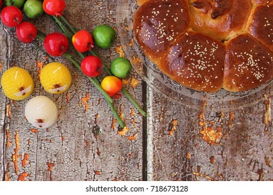 Sweet Challah bread with apples and pomegranate for Jewish holiday kiddush ceremony