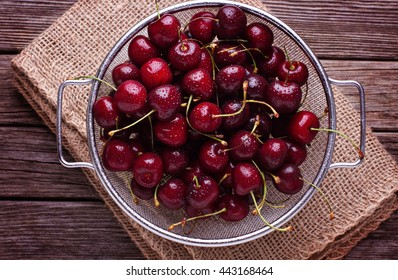 Sweet cherries in sieve