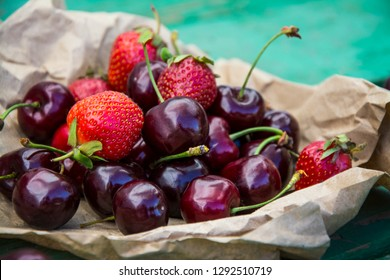 Sweet  Sweet cherries and strawberries. Fruit background.