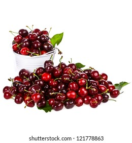 Sweet cherries in a white metal bucket isolated on white background