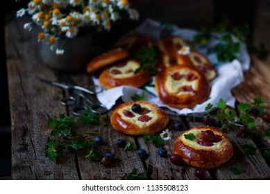 Sweet Cherry Filled Buns .style rustic. selective focus