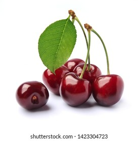 Sweet cherry with leaves isolated on white backgrounds.