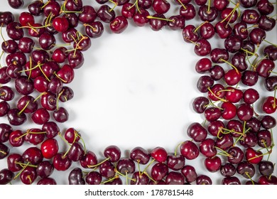 Sweet cherry on a white background with a place for an inscription