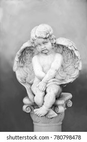 sweet cherub with wings on a pedestal