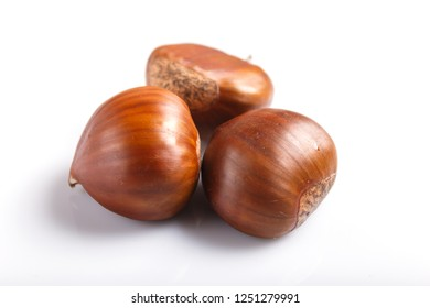 sweet chestnuts isolated on white background. closeup, macro.
